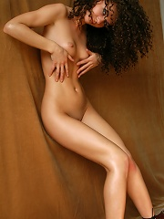 Zemani.com Lyuda - Curly young girl with beautiful body poses nude indoor.