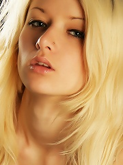 Seductive blonde with alluring, girl-next-door beauty and nubile body.