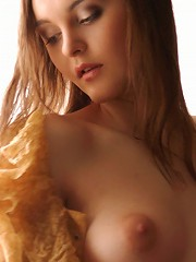 Zemani.com Natasha - Young girl with nice body and hairy pussy take her clothes off and poses nude on the window sill.