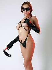Sexy dominating lady in leather panties, stripes and mask
